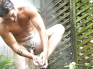Fully naked gay hunk shows off his body outdoors